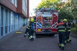 Trappenhuis parkeergarage vol met rook na brand